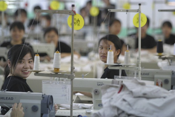 A sweat shop in China where clothing is manufactured.